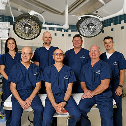 group of physicians in operating room