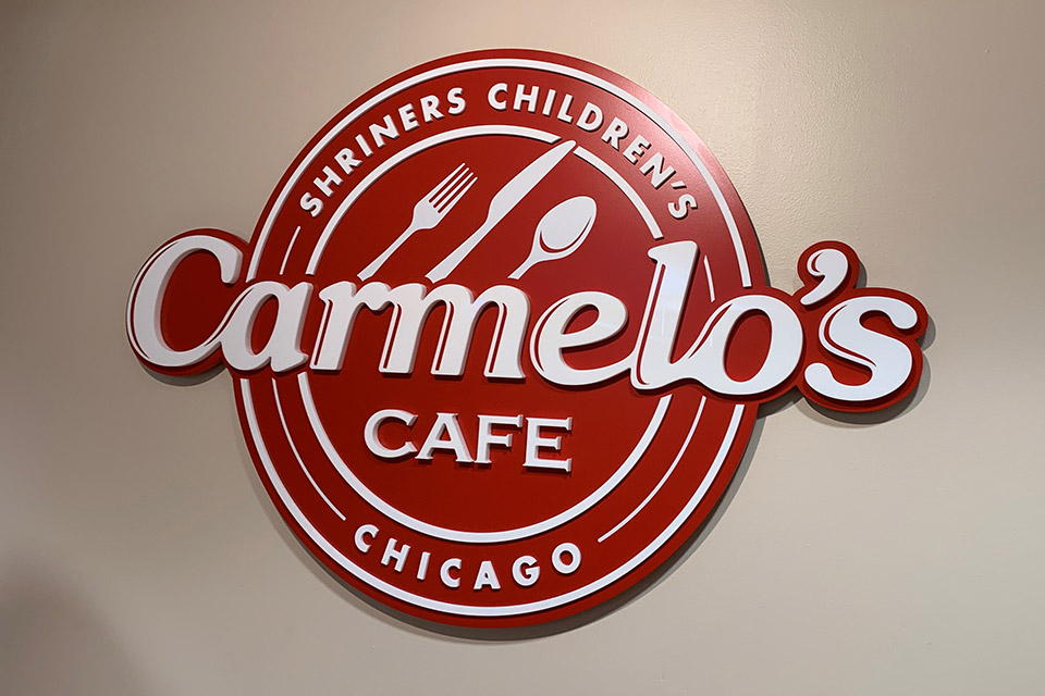 Carmelo's Cafe sign