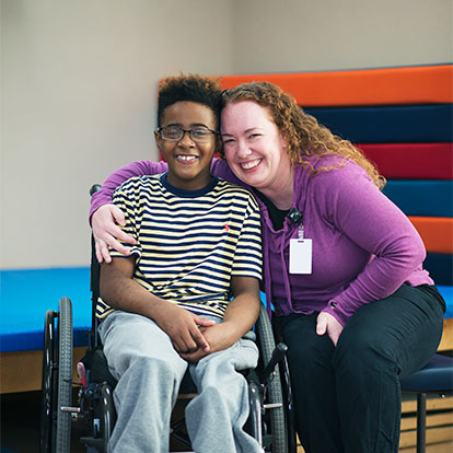 patient in wheelchair with staff member