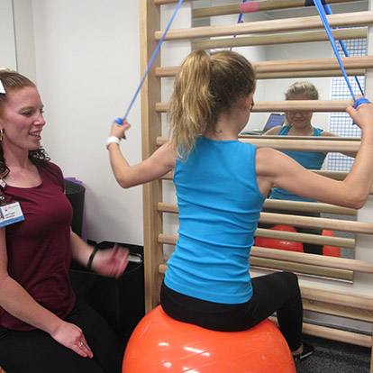 patient and physical therapist during PT session