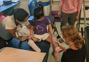 patient with prosthetic and staff members