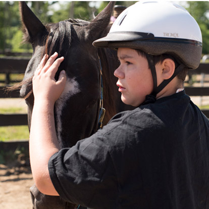 patient with horse at camp