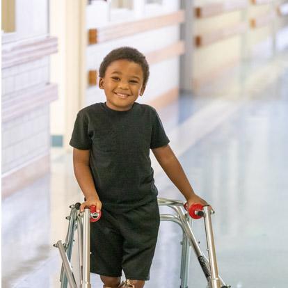 male patient using walker