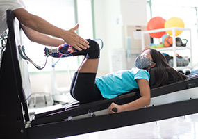 patient during prosthetic leg therapy session