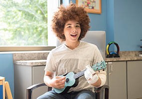 patient playing ukelele