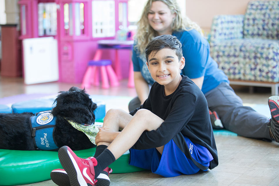 Ayden with pet therapy dog
