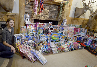 Carleigh at home with donations