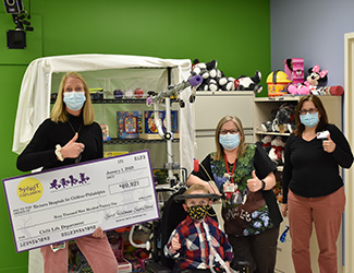 Check donation with patient and a few staff members