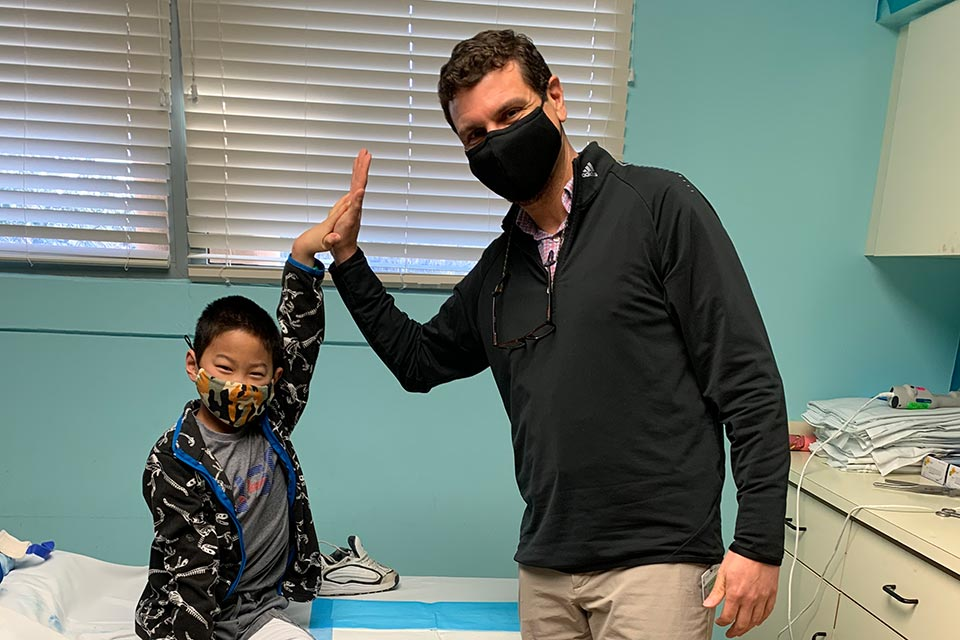 Daniel and Dr. Khoury high five