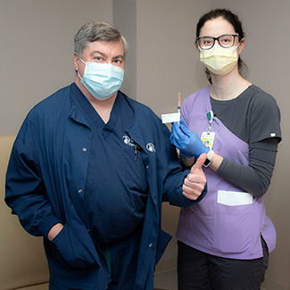 Doctor Mooney with staff member