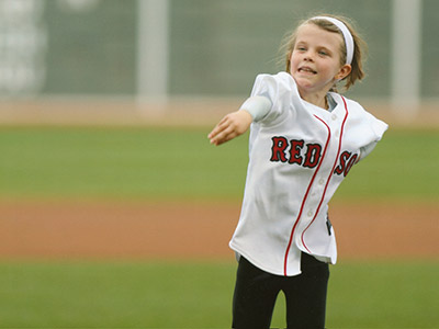 Ella throwing first pitch at Fenway Park