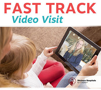 mother and child using fast track video visit on tablet