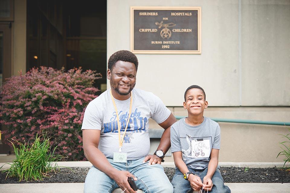 Frankie and father outside Cincinnati Shriners Hospital
