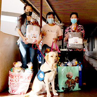 Group and dog with donations