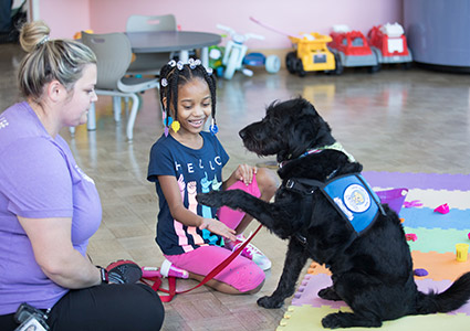 Jordyn with therapy dog