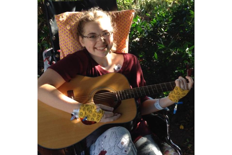 Lorryn playing guitar