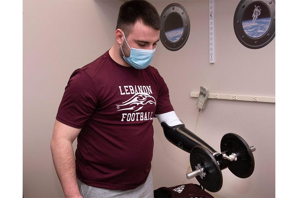 Mason lifting weights