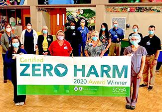 Staff members holding award banner