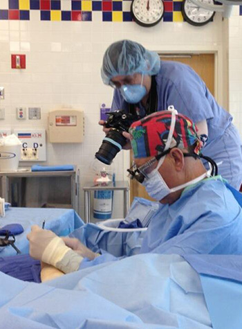 Sue Brogna at work in operating room