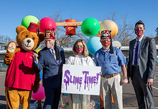 Sutherd with Shriner leaders and Fezzy