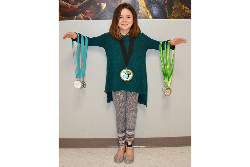 Zuleikha with gymnastics medals