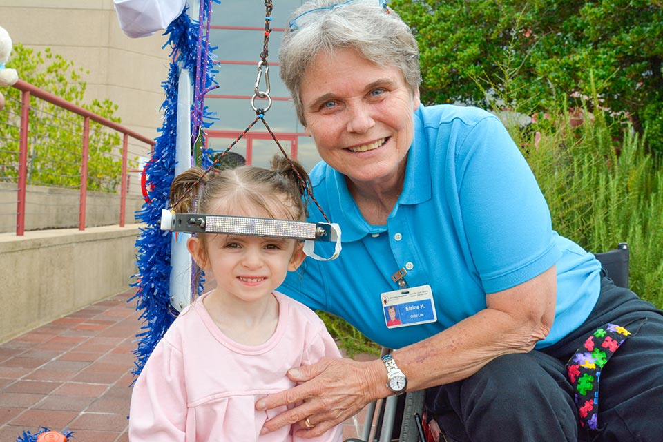 Elaine outdoors with one of the many patients she has cared for
