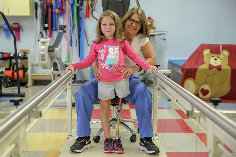 physical therapist and female patient with leg prosthesis