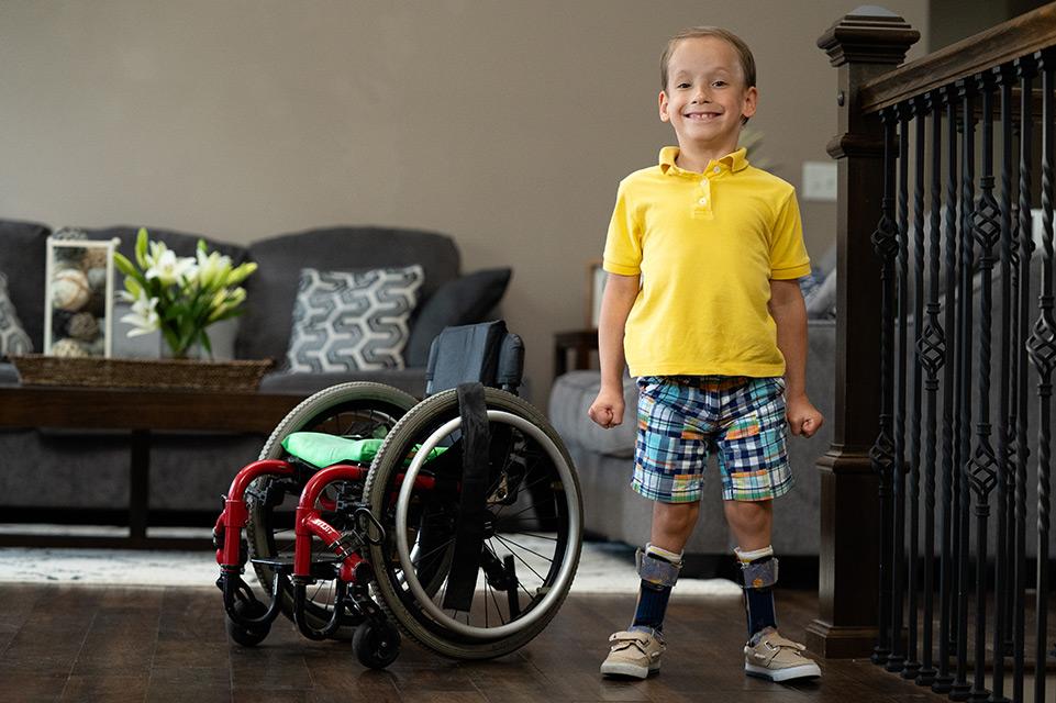 patient standing next to wheelchair