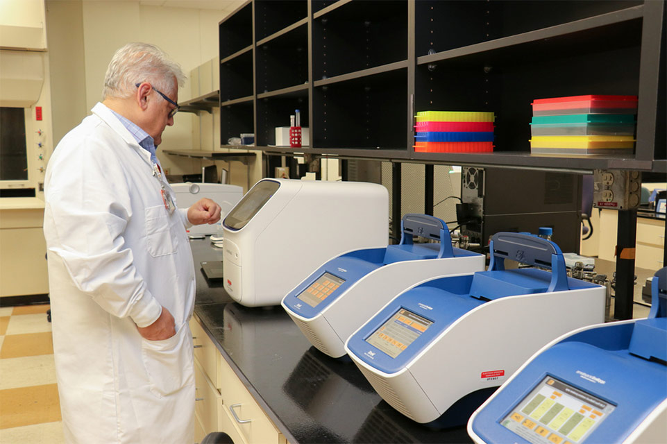 researcher in genomic lab